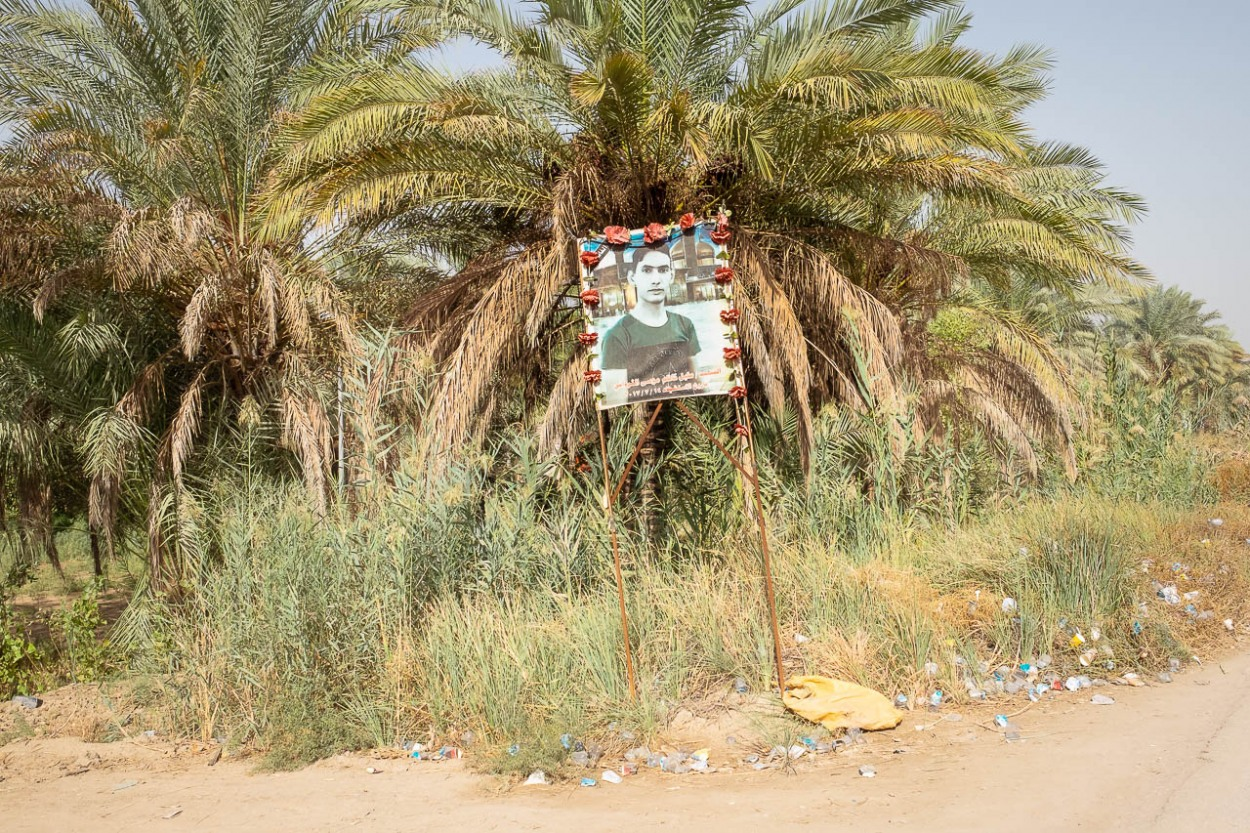 A poster commemorates a martyr on the way to the Euphrates River in Al-Hilla, Iraq