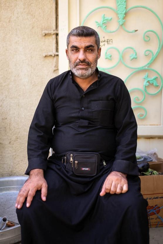 A shiite worshiper in front of his family mawakeb in Kerbala, Irak