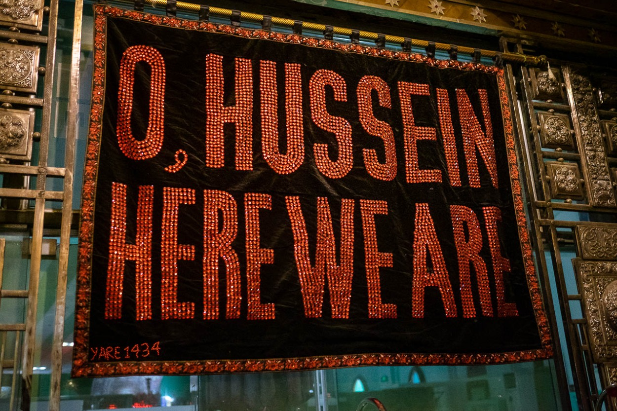 Sign at the entrance of the museum in the shrine or mausoleum of Imam Hussein which summarizes the feeling of millions of Shiites who walk to Karbala: Labbaik ya Hussein