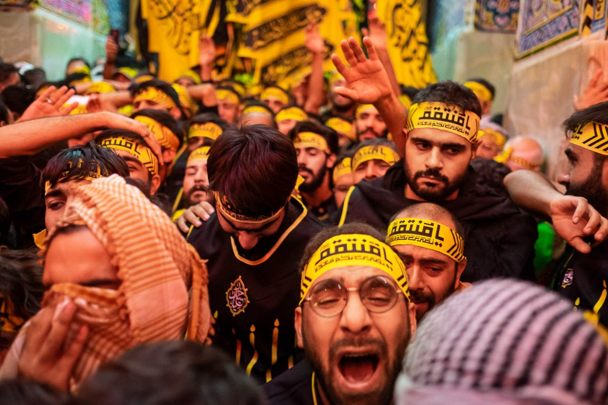 Brothers of the Heyat Honar brotherhood express their pain as they leave the Imam Hussein Mausoleum in Karbala, Iraq