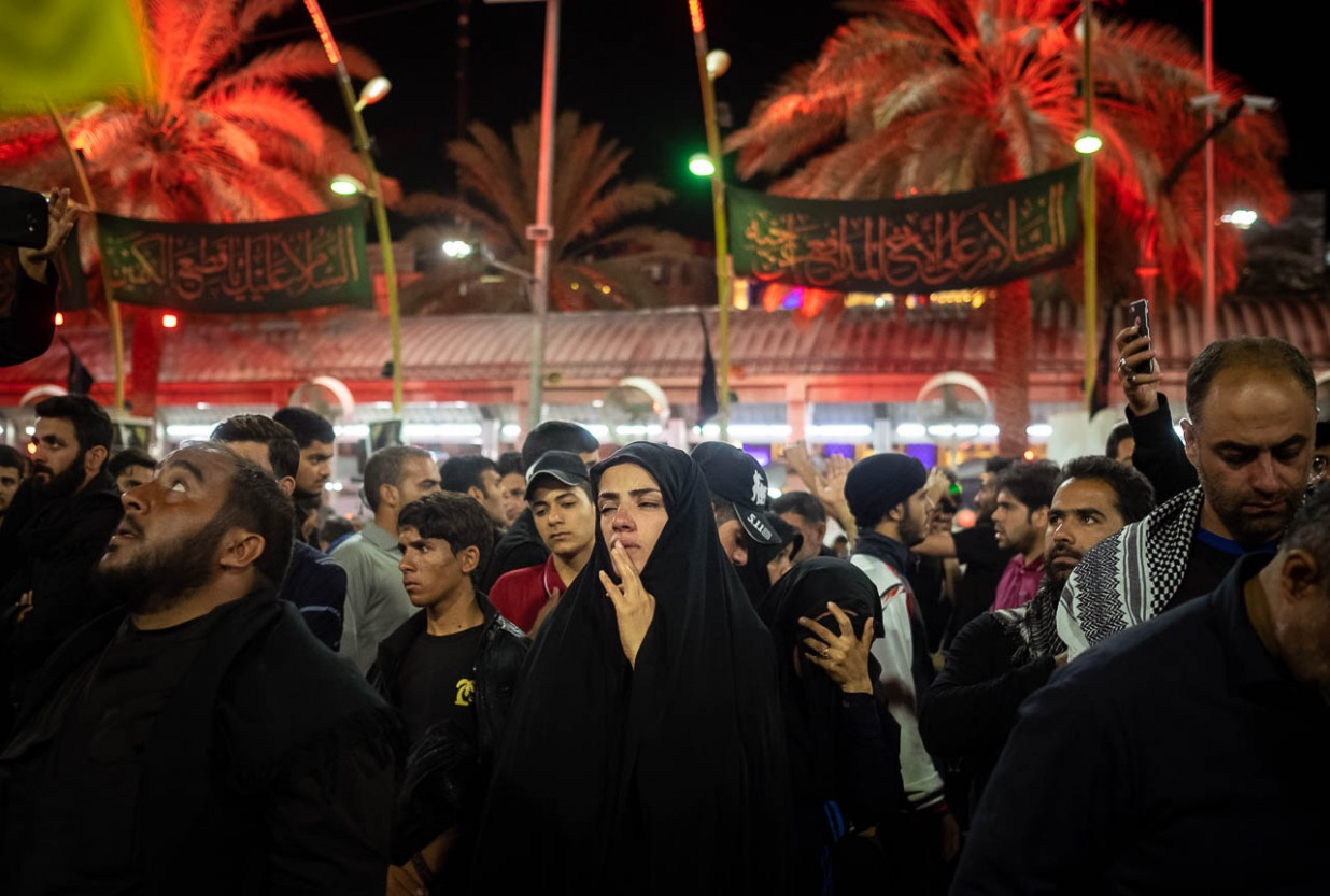 Faithful afflicted in their pain remembering martyrdom of Imam Hussein in Bain ul Harmain, the space between the mausoleums of Imam Hussein and Hazrat Abbas in Karbala, Iraq