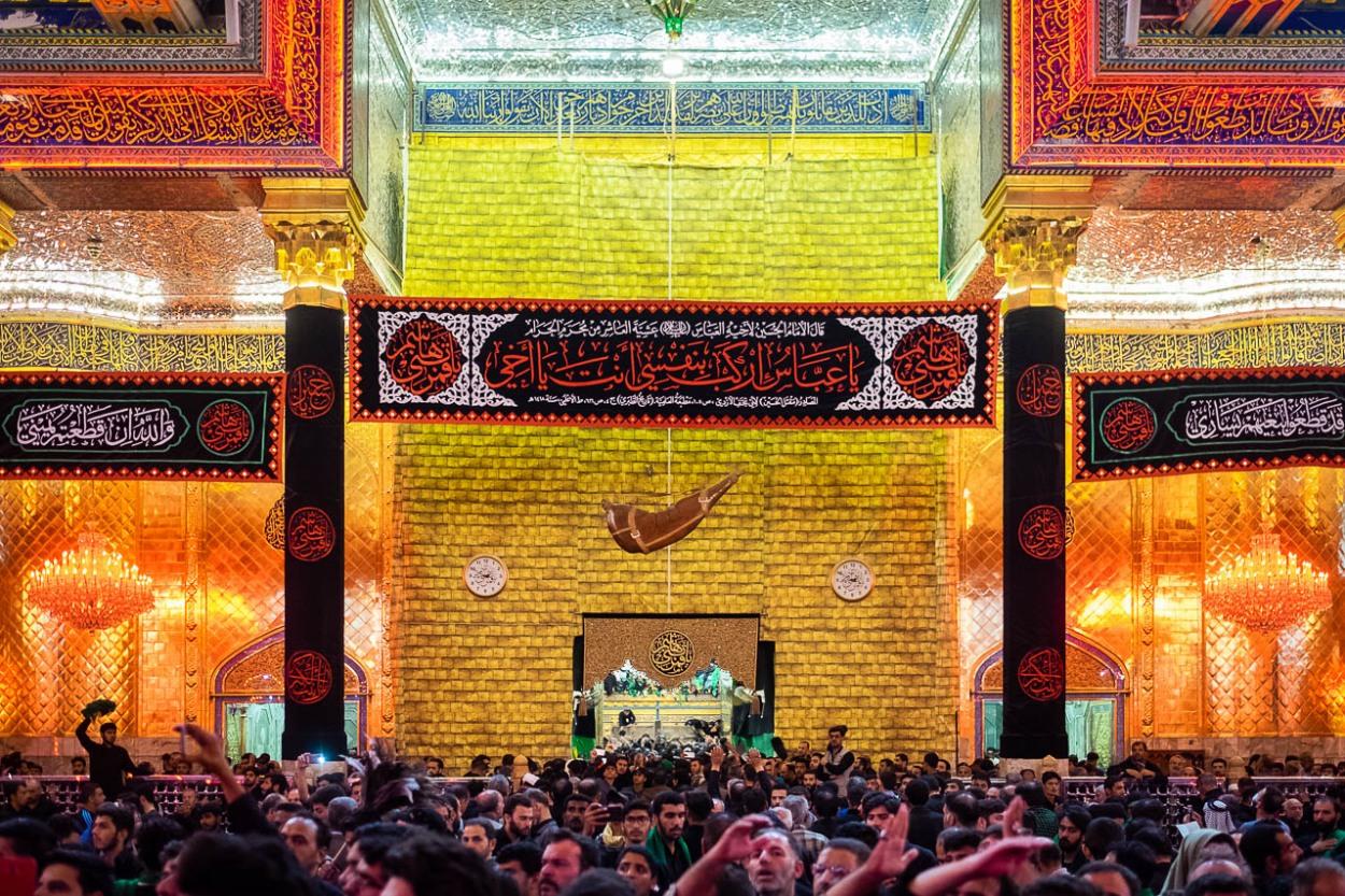 Shiite faithful express their devotion inside in the Abolfazl  Abbas mausoleum in Karbala, Iraq. Abolfazl Abbas or Abbas ibn Alí was the son of Imam Hussein.
