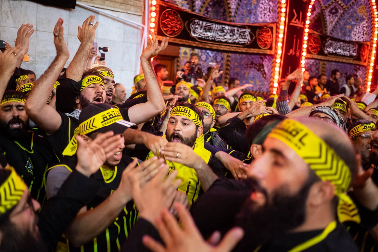 Brothers of Heyat Honar express their pain in the mausoleum of Abolfazl Abbas in Karbala, Iraq