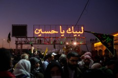 """First night after leaving Najaf to reach Kerbala, Iraq and we stopped at Imam Reza rest area to sleep. In the neon lights, a religious motto that is heard and read everywhere like a fidelity and compromise contract: """"Here I am Hussein"""""""