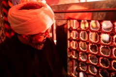 Sheikh Mohammad Khodadadi looks at the Imam Hussein mausoleum in Karbala. The Shrine is the mosque and burial site of Hussein ibn Ali, the third Imam of Shia Islam, near the place where he was martyred during the Battle of Karbala in 680 BC. The tomb of Hussein is one of the holiest places in Shia Islam, outside of Mecca and Medina.
