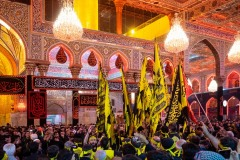 Brothers of Heyat Honar express their devotion inside in the mausoleum of Imam Hussein in Karbala, Iraq