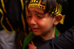 A young brother of Heyat Honar brotherhood express his pain and suffering inside the mausoleum of Imam Hussein in Karbala, Iraq