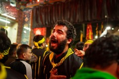 A brother of the Heyat Honar brotherhood express his pain as he leaves the Imam Hussein Mausoleum in Karbala, Iraq